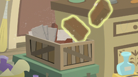 Antique bricks floating out of a crate S7E24