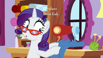 Rarity glancing over at her sewing project S9E7