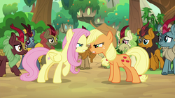 Fluttershy and AJ arguing among the Kirin S8E23.png