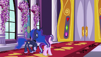 Luna and Starlight in front of large castle doors S7E10