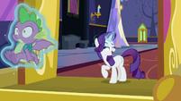 Rarity catches Spike in her magic aura S9E19