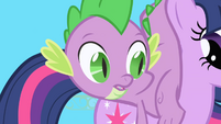 Spike lands on Twilight's back S1E01