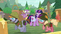 Twilight and Spike watch ponies in war gear S9E5