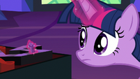 Twilight moves her game piece by one space S7E24