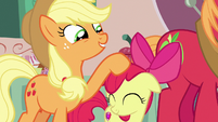 Applejack tousling Apple Bloom's mane S7E13