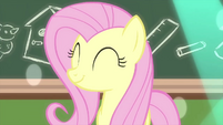 Fluttershy smiling at the students' fun MLPS3