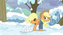 Applejack kicks up a snowball S5E5