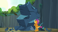 Smolder looking at the giant rock S9E3