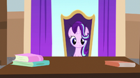 Starlight sitting in Twilight's office chair S8E15