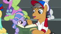 Quibble holding a blowing leaf S9E6