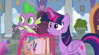 Twilight and Spike look toward the doors S9E3