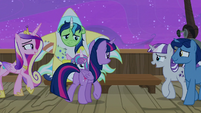 Sparkle family members moving toward a bench S7E22