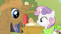 Sweetie Belle and mud covered Rarity look at eggs S2E05