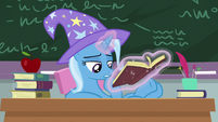 Trixie flipping through history book pages S9E20