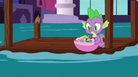 Spike picks up a bowl of gems S5E10