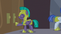 Guard Chrysalis lightly pushes at the doors S9E17