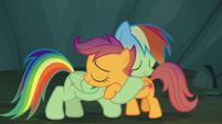 Rainbow and Scootaloo share a sisterly hug S7E16