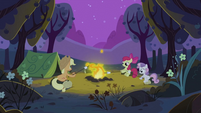 Applejack, Apple Bloom and Sweetie Belle sitting around the campfire S2E05