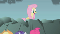 Fluttershy looking at her knocked-down friends S01E07