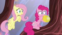 Pinkie Pie breathes heavily into a balloon S5E19