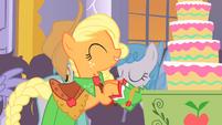 Applejack bringing apple cake into hall 2 S1E26