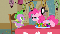 Pinkie Pie bringing over a lamp S1E25