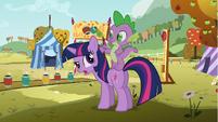 Spike standing on Twilight's back S1E13