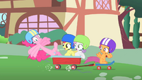 Pinkie Pie about to fall off the wagon S1E23