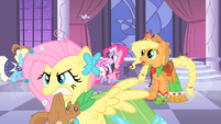 Fluttershy holding a squirrel in her mouth S1E26