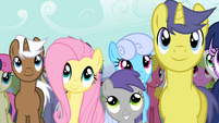 Fluttershy listening to AJ's speech S2E14