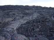 Aa next to pahoehoe lava at Craters of the Moon NM