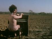 Nude organist9