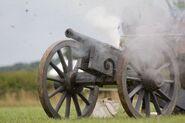 5274590-english-civil-war-cannon-firing-in-battle