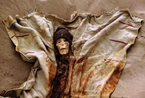 A mummy from the Northern Cemetery wearing a hat and cloak