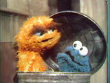Visitors to Oscar's trash can