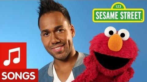 """Sesame_Street_Romeo_Santos_and_Elmo_sing_""""Quiero_Ser_Tu_Amigo"""""""