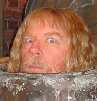 Michael McKean in Oscar's trash can
