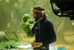 Jim Henson looking at Kermit