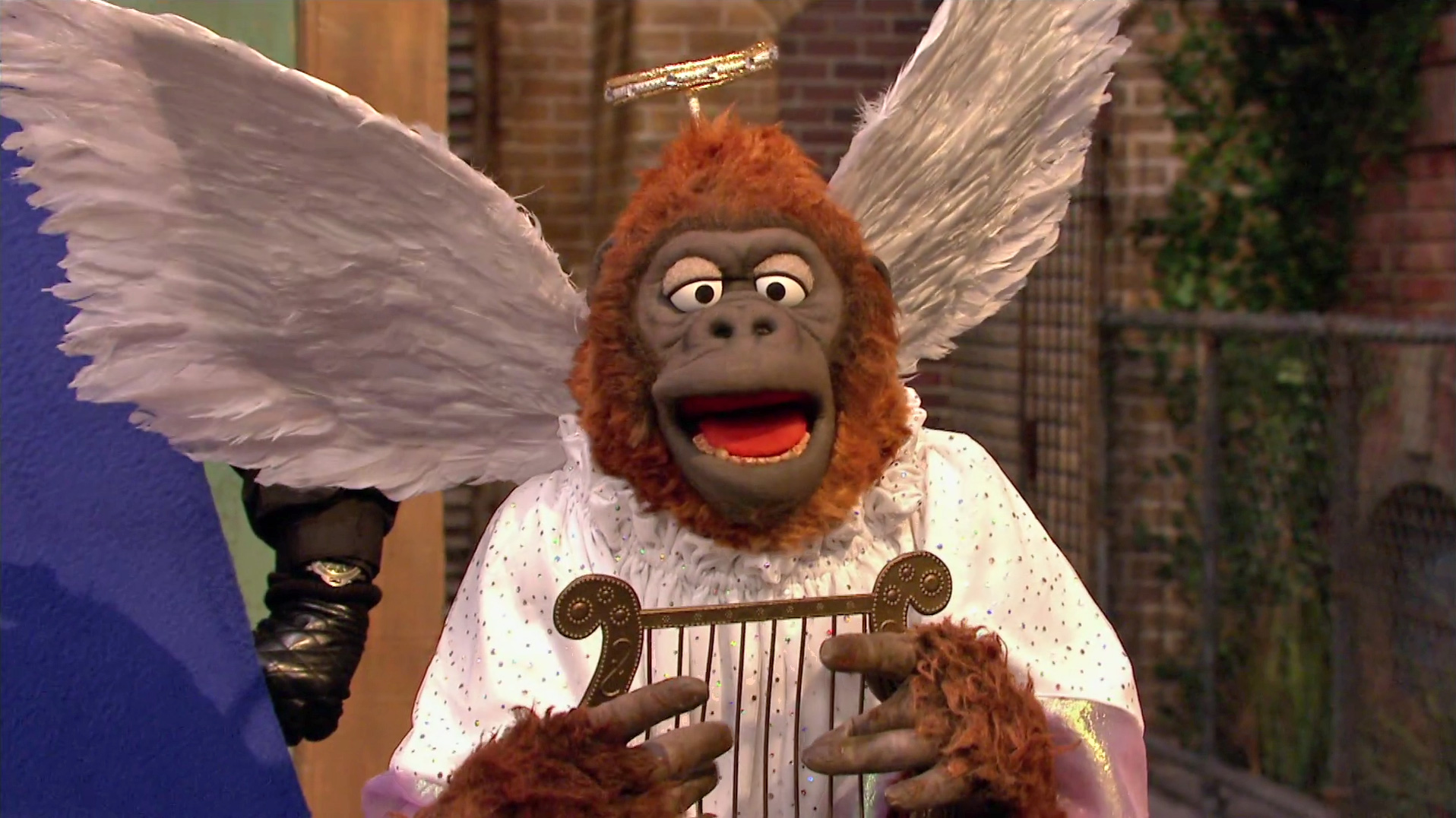 An ape dressed as an angel singing about acorns