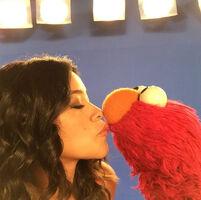 Gina Rodriguez kiss Elmo