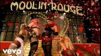Christina_Aguilera,_Lil'_Kim,_Mya,_Pink_-_Lady_Marmalade_(Official_Music_Video)