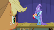 Trixie holding flowers S1E06