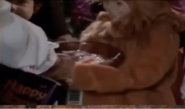 S1E09 Graham giving a bowl to a lion trick-or-treater
