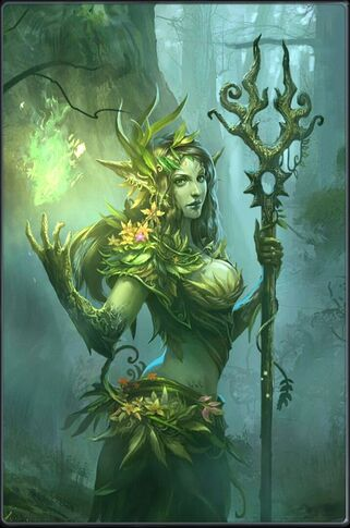 A green skinned woman with bark like a tree. She has plants and flowers growing over her.