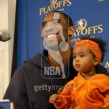 Kobe Bryant laughs with his daughter Natalia while talking to the press.jpg