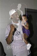 Kobe Braynt celebrates as he holds his baby Natalia