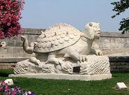 Tarasque statue near King René's castle in Tarascon, pub dom