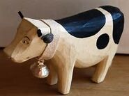 A wooden cow is dropped in Cowcity, Yiddian
