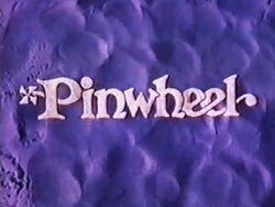 Pinwheel-title-card-purple-sand.jpg