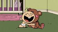Lily hugs her teddy bear
